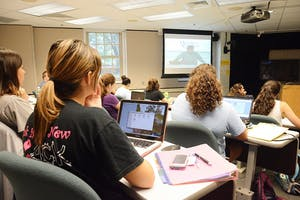 Students listen to Tom Belt, an instructor of Cherokee who teaches five different levels of the class at UNC via webcam.