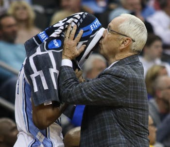 Head Coach Roy Williams kisses senior guard Kenny Williams (24) on the forehead at the end of UNC's 97-80 loss against Auburn in the Sweet 16 of the NCAA Tournament on Friday, March 29, 2019 at the Sprint Center in Kansas City, M.O.
