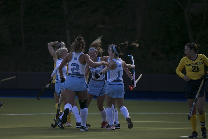 The UNC field hockey team celebrates after scoring their fifth goal against Michigan during the second round of the NCAA Tournament Sunday, Nov. 11, 2018 in Karen Shelton Stadium. UNC won 5-2 to advance to the final four.