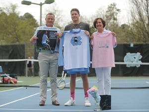 """Senior Blaine """"Bo"""" Boyden is honored during a match on Senior Day against Notre Dame on Sunday, April 7, 2019. UNC won 5-0."""