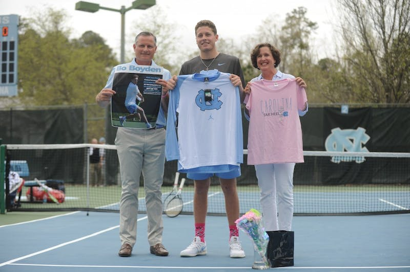 "Senior Blaine ""Bo"" Boyden is honored during a match on Senior Day against Notre Dame on Sunday, April 7, 2019. UNC won 5-0."