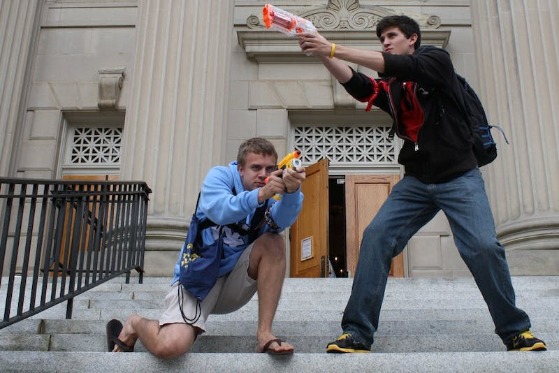 Freshmen Ethan Butler and Andrew Burchins, who were both humans as of Monday afternoon, participate in the campus-wide Humans v. Zombies game.