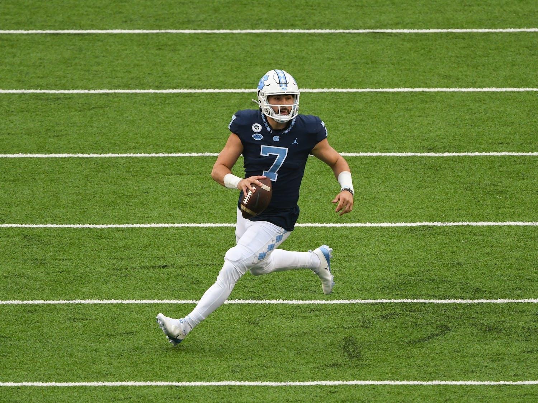 UNC sophomore quarterback Sam Howell (7) runs downfield in Kenan Memorial Stadium during a game against Virigina Tech on Oct. 10, 2020. UNC beat Virigina Tech 56-45.