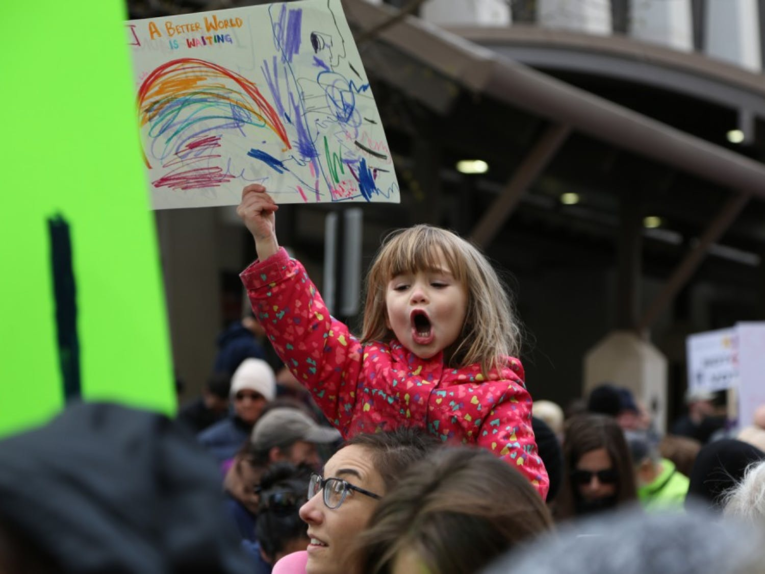"""A young girl holds up a sign at the March for Our Lives rally in Raleigh saying, """" A Beautiful World Awaits"""" on Saturday March 24th."""