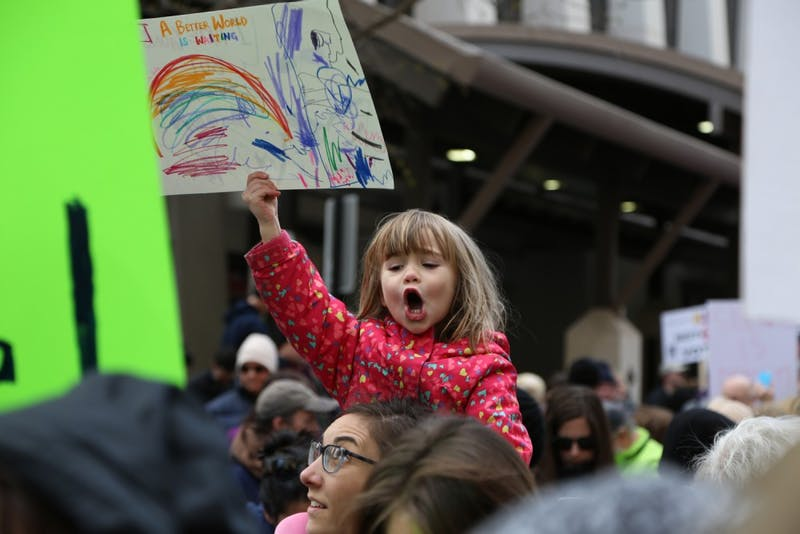 "A young girl holds up a sign at the March for Our Lives rally in Raleigh saying, "" A Beautiful World Awaits"" on Saturday March 24th."