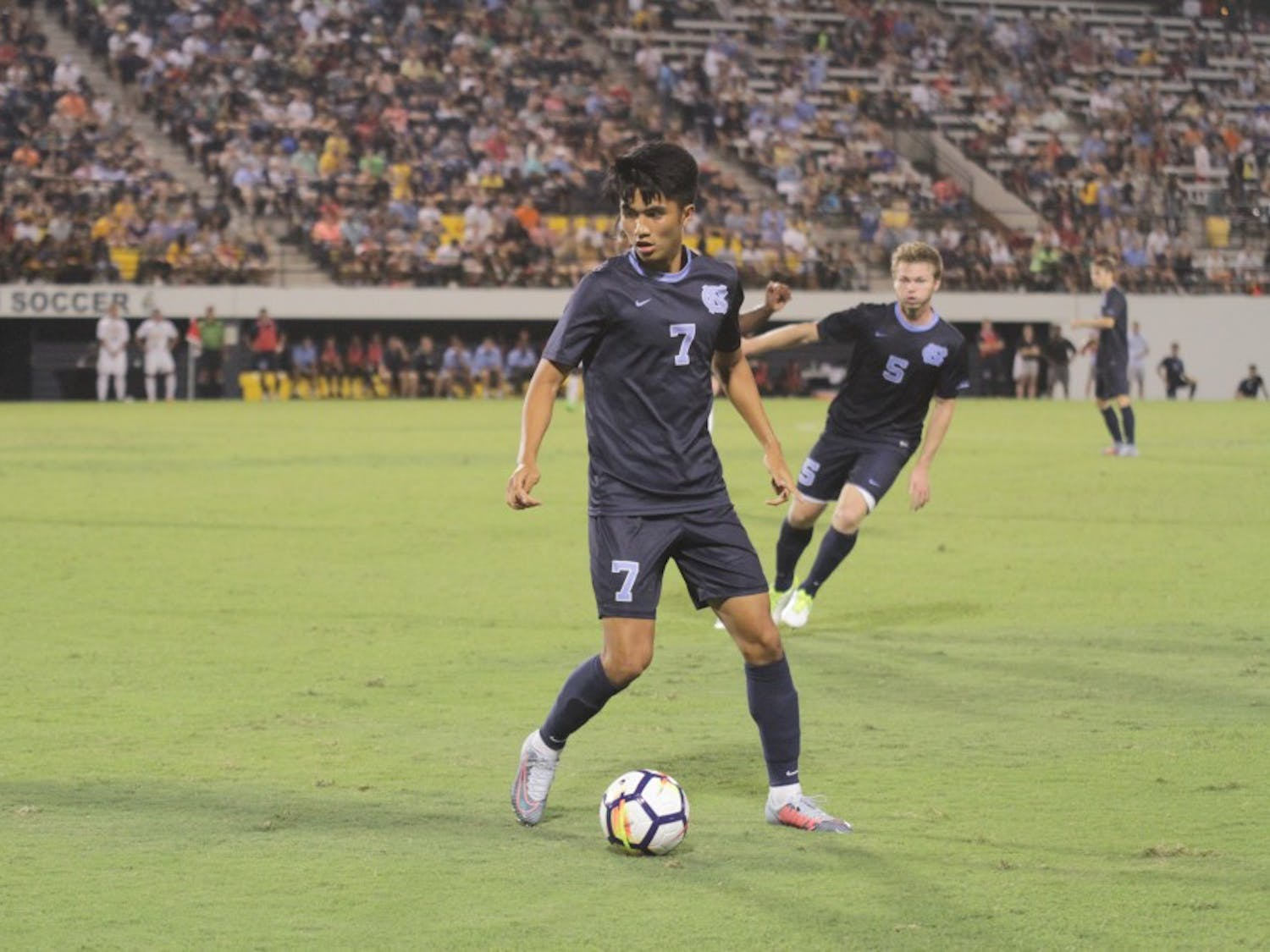 First-year Lucas del Rosario (7) controls the ball against UNC-Greensboro on Monday night.
