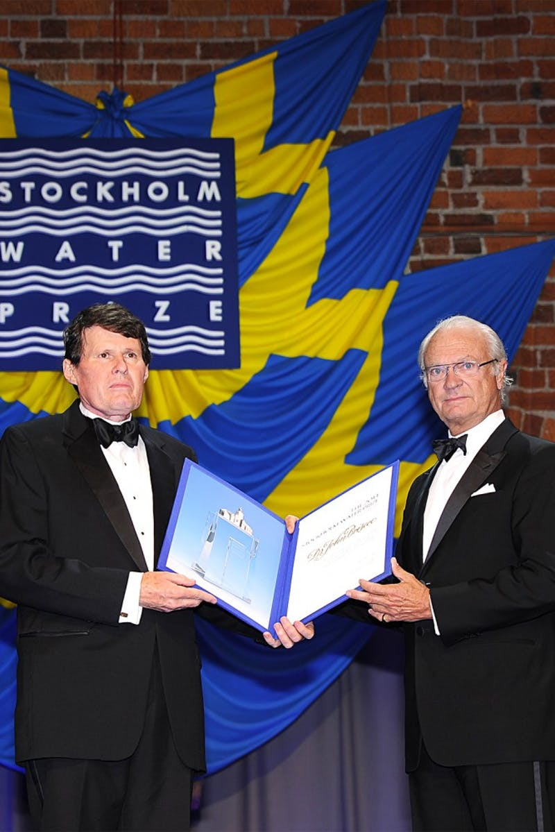 Former UNC professor John Briscoe (left) received the Stockholm Water Prize earlier this year for his work on global water policies. Courtesy of Marta Briscoe Benton.