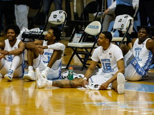 UNC senior forward Garrison Brooks (15) sits on the floor during senior night speeches in the Dean Dome on March 6, 2021. The Tar Heels beat the Blue Devils 91-73.