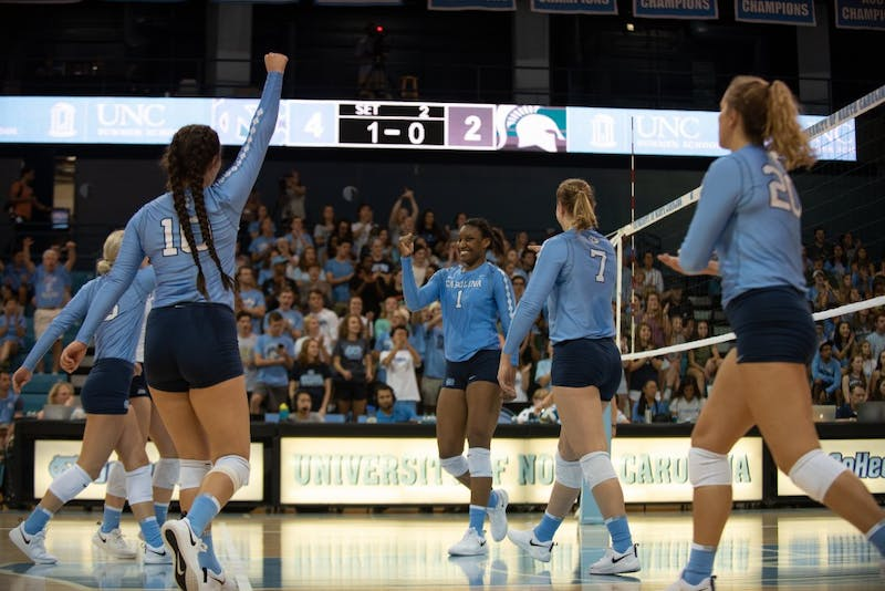 Outside hitter Destiny Cox (1) celebrates during a 3-1 loss to Michigan State in Carmichael Arena on Sept. 1.