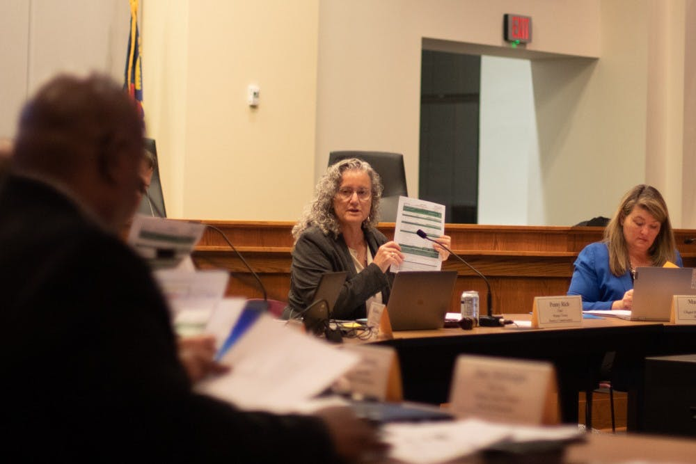 Orange County Commissioner Penny Rich reviews documents at a joint school boards meeting between Orange County Public Schools, Chapel Hill-Carrboro City Schools and the Board of County Commissioners. The meeting took place on Tuesday, Feb. 25, 2020 at the Whitted Building in Hillsborough, N.C.