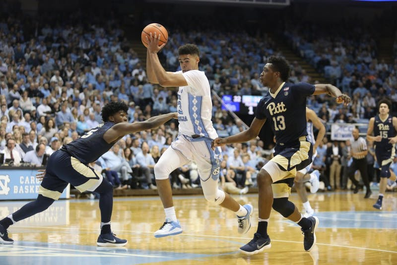Guard Cameron Johnson (13) splits two Pittsburgh defenders during a Feb. 3 game in the Smith Center.