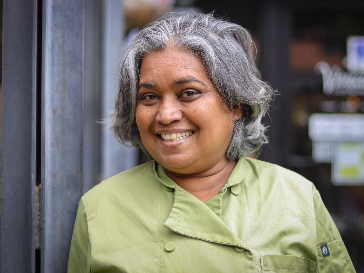 Vimala Rajendran is the chef and founder of Vimala's Curryblossom Café in downtown Chapel Hill. She poses outside of her restaurant on Monday, April 19.