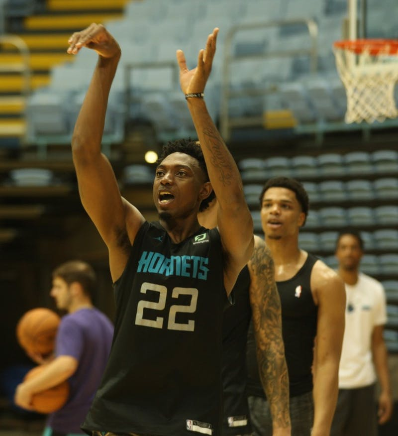 Charlotte Hornets forward Robert Franks (22) shoots around after training camp practice in the Dean E. Smith Center on Friday, Oct. 4, 2019.