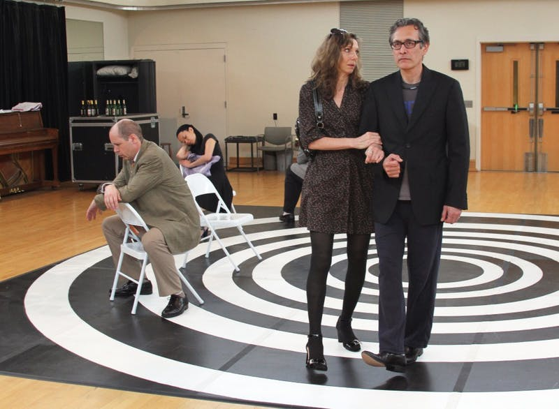 """SITI Company members Ellen Lauren, playing the character Marie, and Stephen Webber, playing Bruno, practice for the play """"Who Do You Think You Are."""""""