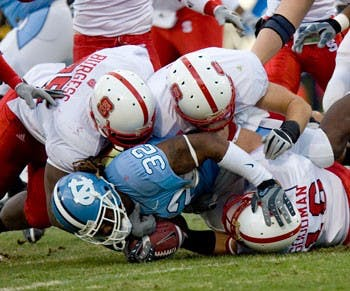 North Carolina?s Ryan Houston rushed for the Tar Heels? only touchdown in the third quarter against N.C. State on Saturday. The Wolfpack stymied the UNC running game as the Tar Heels amassed a meager 56 yards on the ground on 26 rushes in UNC?s fourth ACC loss.