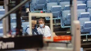 UNC chancellor Kevin Guskiewicz watches the UNC men's basketball team during a game against the College of Charleston in the Smith Center on Wednesday, Nov. 25, 2020. UNC won the game 79-60.