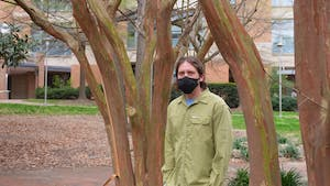Matthew Hirsch poses for a portrait outside of the Neuroscience Research Building on Wednesday, Mar. 31, 2021. Hirsch is an Associate Professor in the Department of Ophthalmology at UNC-CH and the co-founder of RainBio.