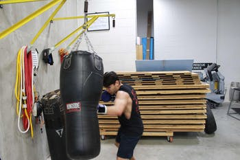 A member of the UNC boxing club practices with a weighted bag. Photo courtesy of Gigi Cloney