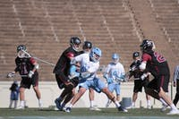 Senior Chris Cloutier (45) rears back for a shot against Lafayette on Feb. 3 in Kenan Stadium.