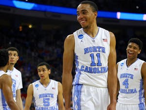 Senior Brice Johnson (11) and the Tar Heels take a time-out during the second half of the Round of 32 March Madness game against Providence.