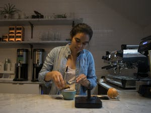 Perennial Coffee and Pastries barista Anna Kasibhatla creates a new brew: a grapefruit infused spiced maple latte in 2017.