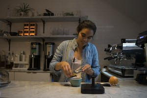 Perennial Coffee and Pastries barista Anna Kasibhatla creates a new brew: a grapefruit infused spiced maple latte.