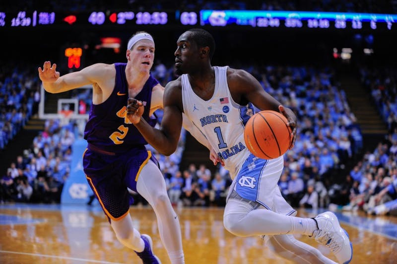 Senior Theo Pinson (1) dribbles around a UNI defender on Friday.