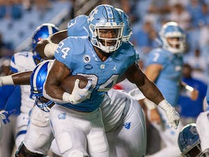 UNC senior running back British Brooks (24) carries the ball at the game against Georgia State on Sept. 11 at Kenan Stadium. UNC won 59-17.