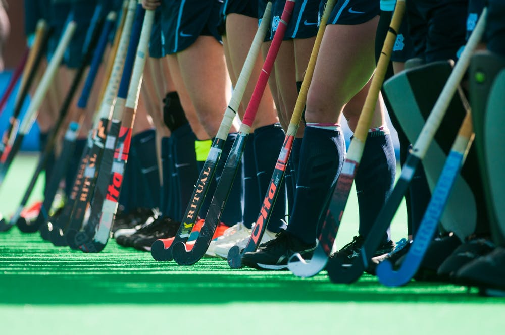 <p>UNC field hockey players stand as the starting lineup is announced during the NCAA Championship Game at Kentner Stadium on Sunday, Nov. 24, 2019. UNC won 6-1, marking their 8th national championship.</p>