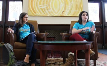 Natalie Borrego and Cora Went discuss their 2013-2014 Campus Y co-president platforms to members of the Campus Y.