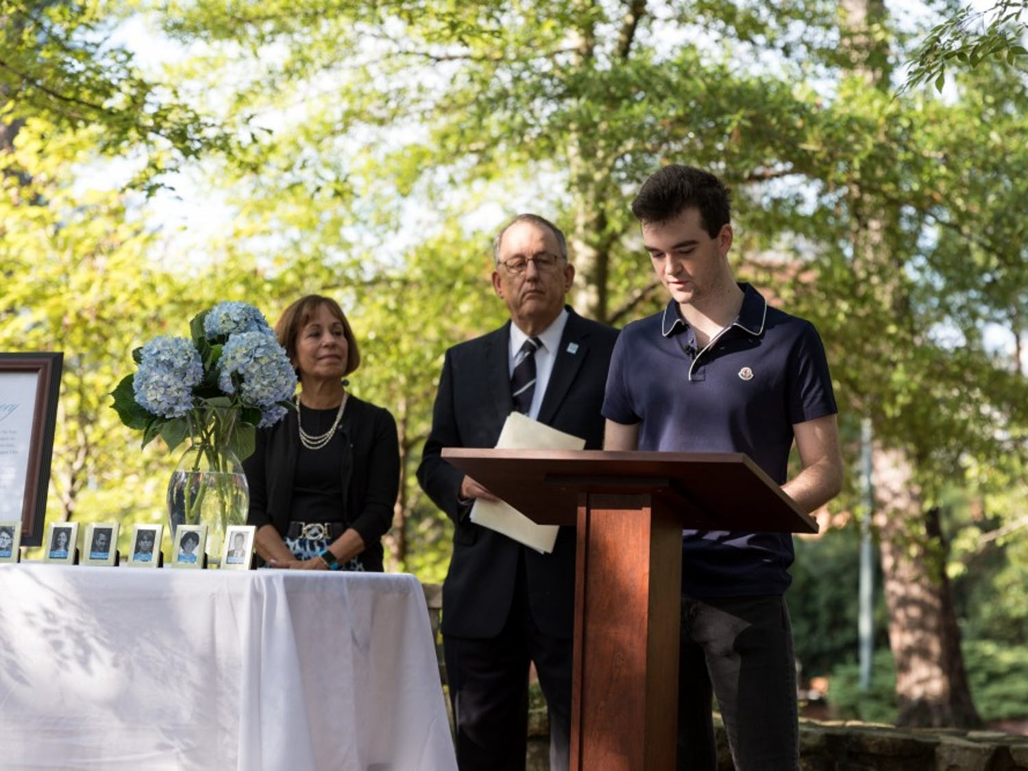 First-year student Dylan Melisaratos speaks briefly about his uncle, Chirstopher Quackenbush, who was a victim in the 9/11 terrorist attack in Memorial Garden near the Alumni Center on the morning ofTuesday, September 11, 2018.