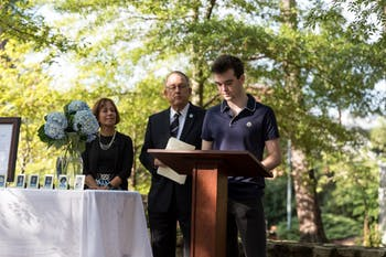 First-year student Dylan Melisaratos speaks briefly about his uncle, Chirstopher Quackenbush, who was a victim in the 9/11 terrorist attack in Memorial Garden near the Alumni Center on the morning of Tuesday, September 11, 2018.