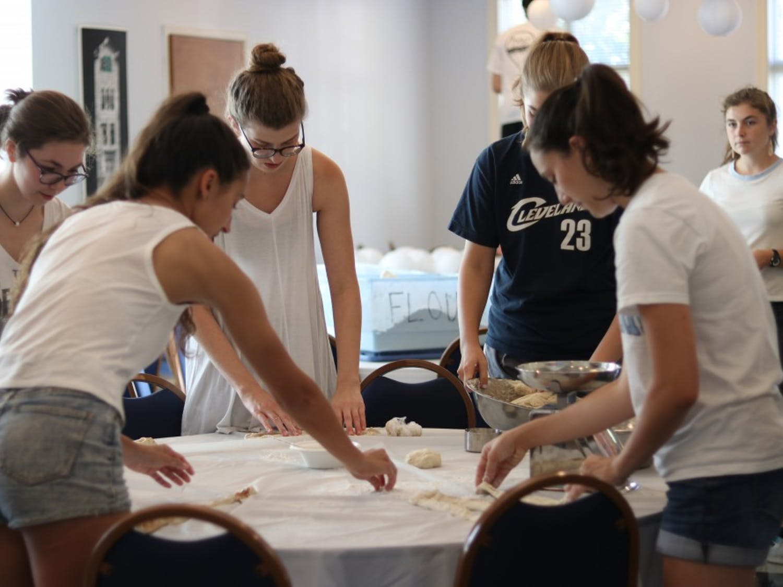 Members Hannah Smith (1st Year), Alex Udell (Junior), Bella Reiss (Junior), Elizabeth Byrd (Junior) and Kenza Araba bake Challah at UNC Hillel on Wed, Sept 27.
