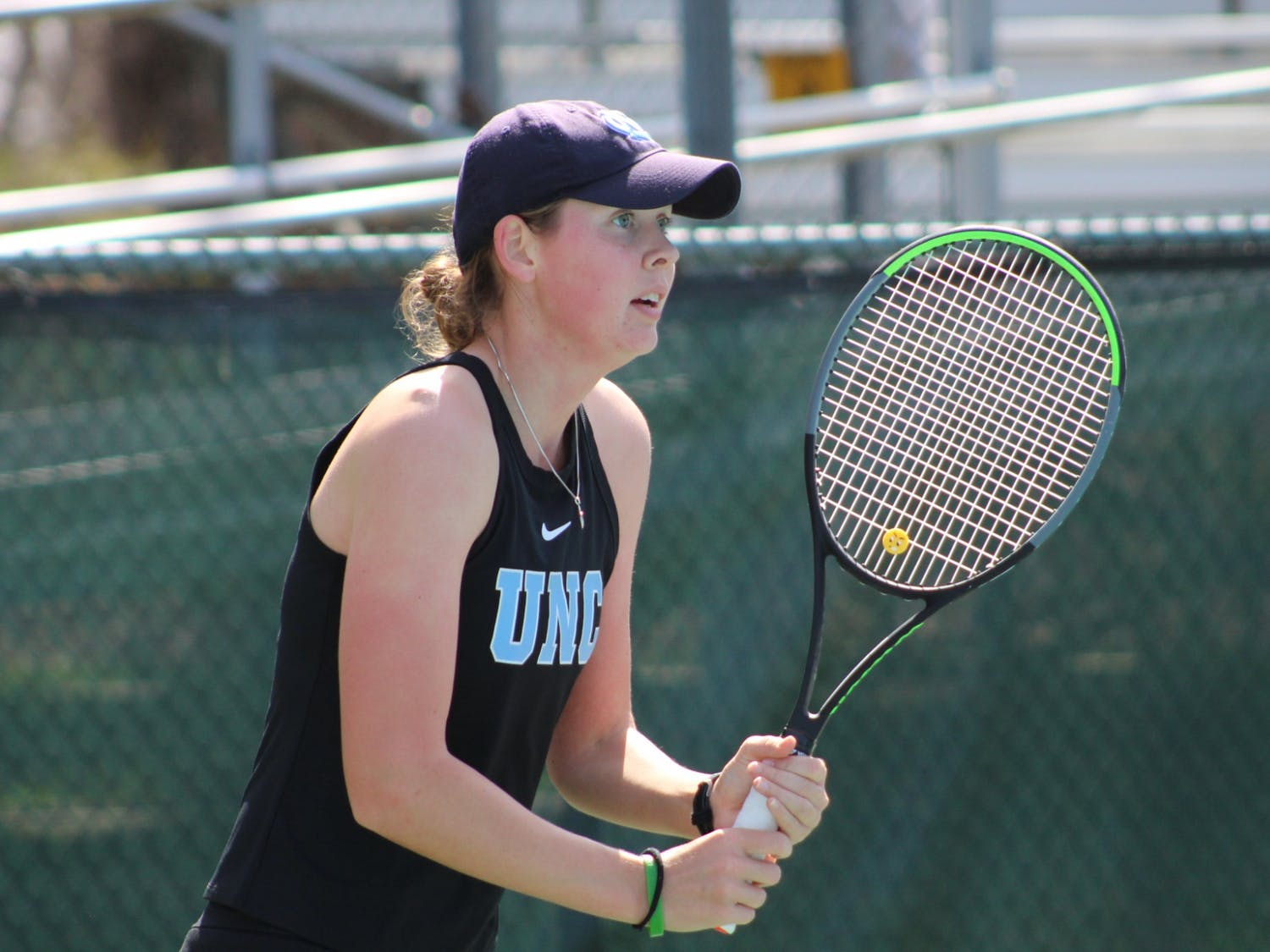 Elizabeth Scotty prepares to return a serve during her victory over Florencia Urrutia from the University of Miami on March 6, 2021.