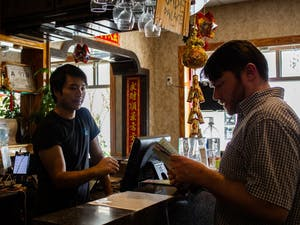 Kevin Wang, age 36 and owner of the Jade Palace restaurant, takes a customer's order on Tuesday, Oct. 1, 2019.