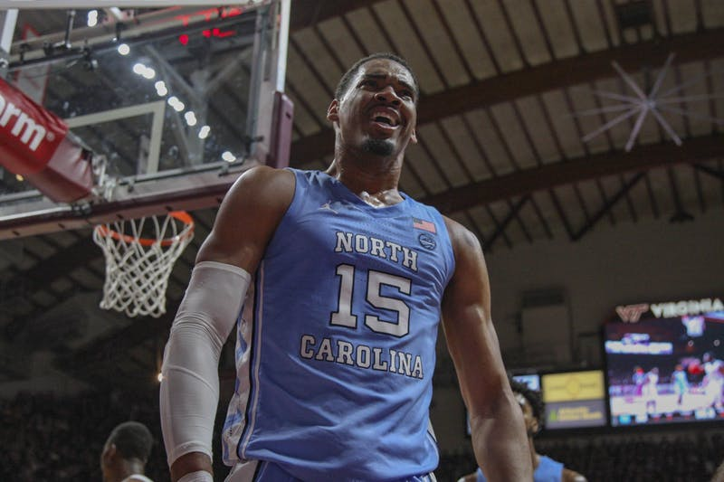 Junior forward (15) Garrison Brooks celebrates after a dunk during the game against Virginia Tech on Wednesday, Jan. 22, 2020 in Cassel Coliseum. UNC lost to VT 79-77.