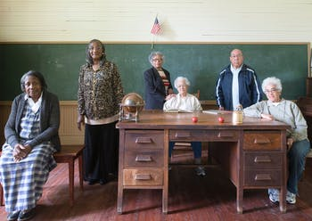 Alumni of the Historic Russell School pose for a portrait. The school is one of several Rosenwald schools, which were built in the Jim Crow era so Black students could receive an education. Photo courtesy of the Historic Russell School.