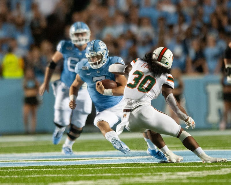 UNC quarterback Sam Howell, number 7, runs with the ball on Saturday, Sept. 7, 2019. UNC beat Miami 28-25.