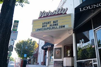 """The closed Varsity Theatre on Franklin Street reads, """"Apart but not alone"""" in reference to the COVID-19 pandemic and social distancing on Thursday, Sep. 3, 2020."""
