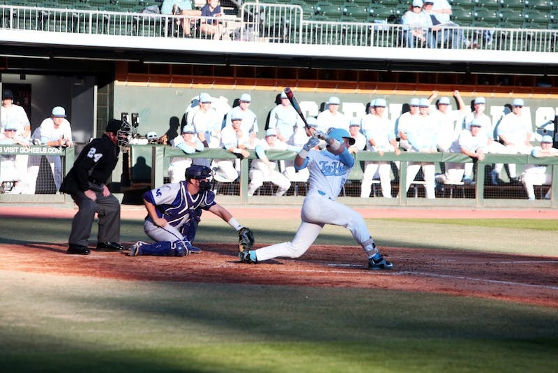 Sophomore Michael Busch (15) swings against High Point on Feb. 27 at Boshamer Stadium.
