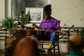 Folk guitarist Yasmin Williams performing at a Sofar Sounds show in Baltimore, Maryland. Photo courtesy of Steve McDonald.