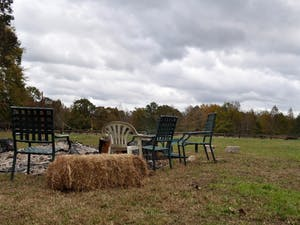 A circle of chairs surrounds firewood in the field by Smokehouse Valley Farm venue in Cedar Grove on Nov. 1, 2018.