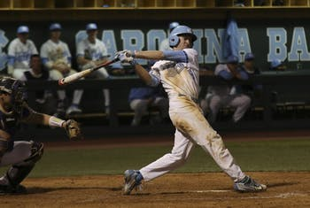 First baseman Ryan Miller (5) follow through on  swing in the bottom of the seventh inning during the North Carolina baseball team's 10-2 route of Western Carolina University on Tuesday.