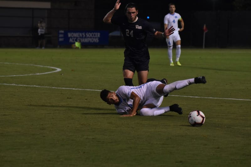 Center defender Mauricio Pineda (2) fights for the ball against midfielder Jackson Walti (24) during Saturday night's game against Pittsburgh at Koskinen Stadium.