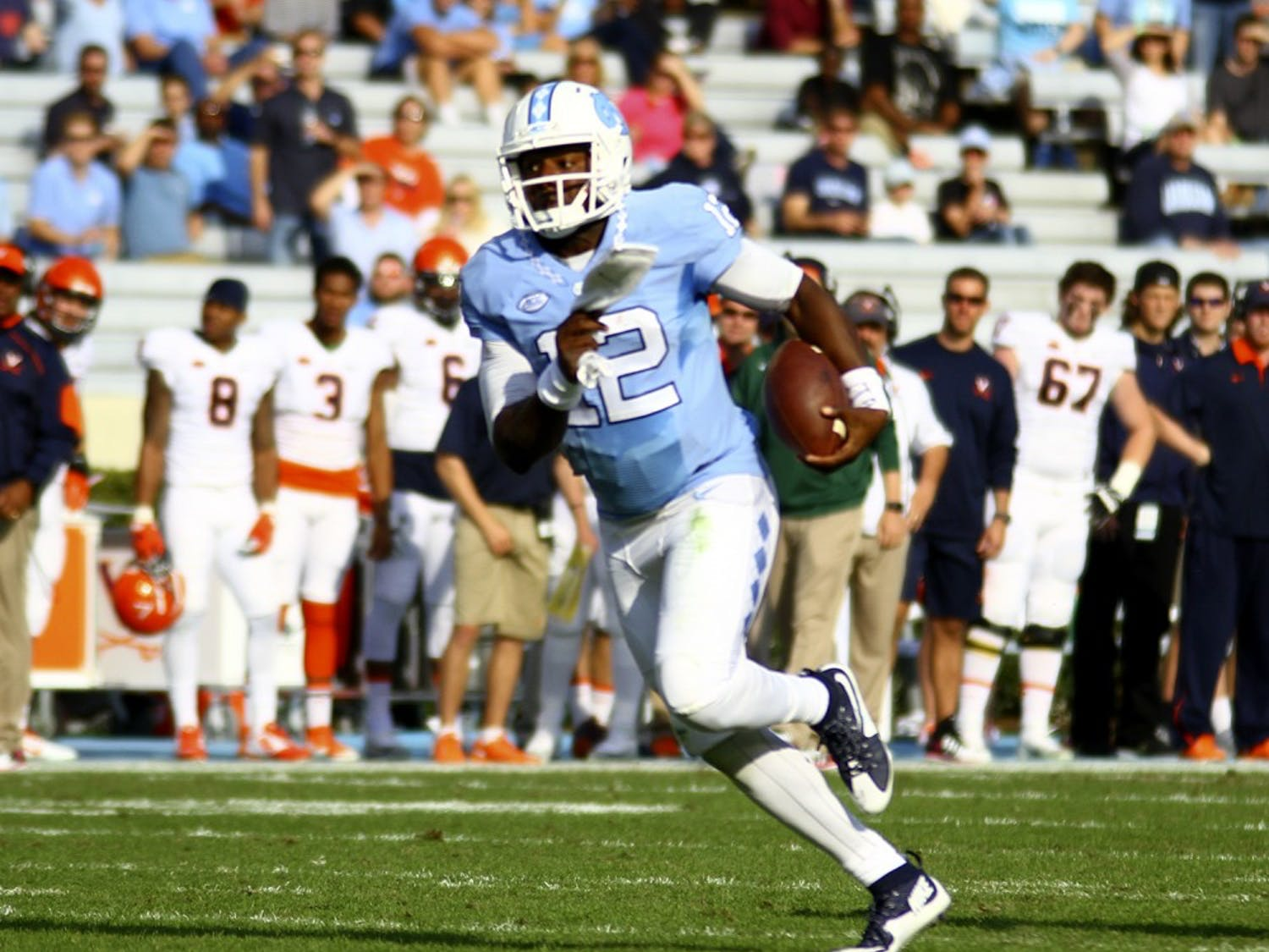 MarquiseWilliams, 12, runs the ball during the UNC-UVa game Saturday. Williams netted 71 rushing yards during the game.