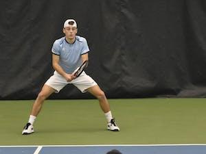UNC men's tennis player Robert Kelly prepares to receive a serve against Vanderbilt.
