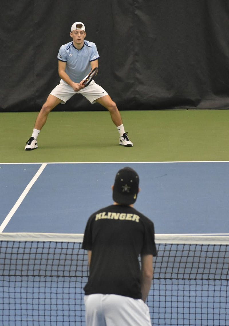 UNC men's tennis player Robert Kelly prepares to receive a serve against Vanderbilt.