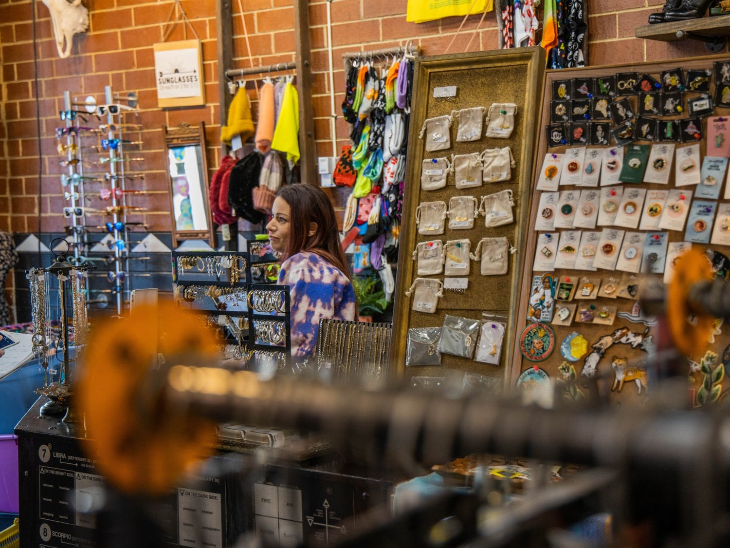 Casey Longyear, co-owner of Rumors, stands in her store's Chapel Hill location at 106 N Graham St on Sunday, March 1, 2020. Rumors is a boutique that buys and resells used clothing.