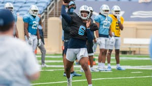 First year quarterback Jacolby Criswell (6) throws the ball at the football practice on Saturday Mar. 27, 2021 at Kenan Stadium.
