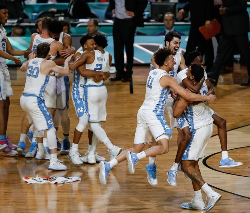 The North Carolina bench erupts into celebration after their win the NCAA Final game against Gonzaga in Phoenix on Monday.